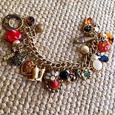Stunning handmade charm bracelet- antique charms! Perfect chic addition to any outfit! Many variations of colors and charms in gold tone! Miss Sadies Antiques Jewelry Bracelets