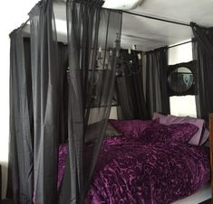 My bed after I hung the homemade canopy and sheer curtains on the curtain rods. I love my idea because I couldn't find a black canopy anywhere. Black and purple are my fave together!