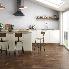 Enjoy the rustic look of real wood without the maintenance. Shop this ceramic tile via the link in our bio. Tile Covers, Faux Shiplap, Lowes Home Improvements, Glazed Ceramic, Real Wood, Home Improvement Projects, Kitchen Remodel, Tile Floor, Living Spaces