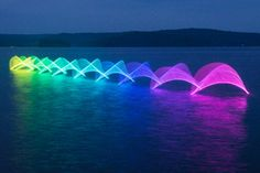 Beautiful designs made from long-exposure photographs of kayakers movements.