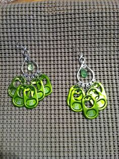 Complete chandelier green Monster Energy tab earrings with green bead.  For sale on Ebay under tweetangel88.