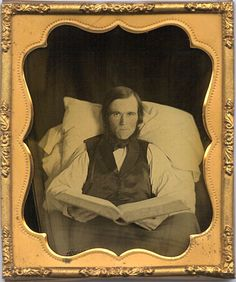 ca. 1860's, [ambrotype portrait of a gentleman, propped up with pillows on a bed, holding a large book] via Christopher Wahren Fine Ph...