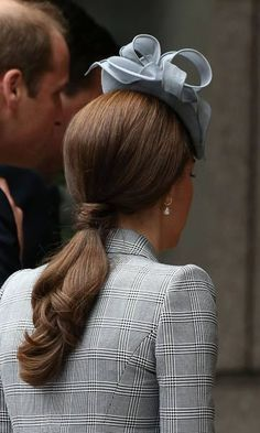 Making her first public appearance since announcing she was pregnant with her second child, Kate kept her hair simple in a chic ponytail.