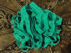"""5/8"""" turquoise stretch lace headband made to fit all ages or purchase by the yard for your own craft or project!!"""
