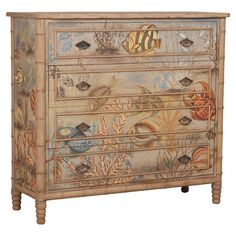 4-drawer mahogany wood chest with a hand-painted fabric applique showcasing an undersea motif.   Product: ChestCons...