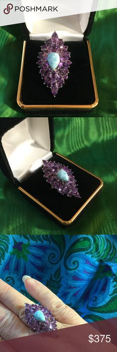 The CROWN JEWELS RING ! IF YOU FEEL FAINT CALL 911 ,  This ring is the prized genuine Larimar and Amethyst Ring of your dreams ! Call your husband ,  call your lover,  call the mailman or is shakedown time !  There are no other rings that compare to this one !  .925 custom made setting ! The Crown Jewels Jewelry Rings