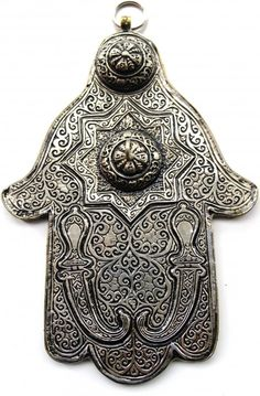 The Hamsa - protection against the evil eye! This version w/ the swords is likely Arabic - called the hand of Fatima - the same in Christianity.