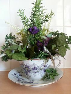 ARTIFICIAL FLORAL ARRANGEMENT - TEACUP OF HERBS AND FLOWERS www.angelfloraldesigns.co.uk