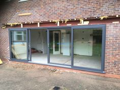 Kommerling Premiline Secured By Design 4 Pane sliding patio doors in Slate grey RAL Installed in Radcliffe On Trent, Nottingham. For a free quotation call us on 01158 660066 visit www.thenottingham… or pop into our West Bridgford showroom. Double Sliding Patio Doors, Aluminium Sliding Doors, Sliding Glass Door, Apartment String Lights, Extension Veranda, Garage Door Design, Bungalow House Plans, External Doors, Cabin Homes