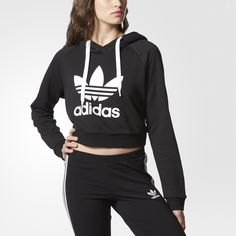 A heritage adidas sportswear look gets reborn in chic, sporty style with this women's hoodie. Made in cozy, heavyweight French terry, this basic pullover is cropped, with a slim, modern fit.