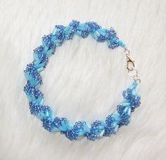 Blue spiral shell shape bracelet by enlora on Etsy