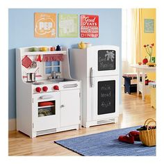 Attrayant Wooden Play Kitchen Sets  Love The Vintage Signs And Chalkboard Fridge.