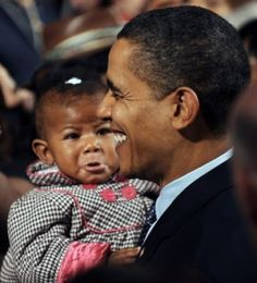 "President Obama holds a baby, at times a gaffe-inducing exercise for a president. Babies cry, and one threw up on Bill Clinton. Currently, Obama is living down his words: ""The private sector is doing fine."""