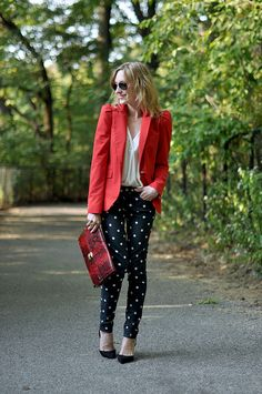 Polka dotted skinnies, a red blazer and a reptile textured clutch.