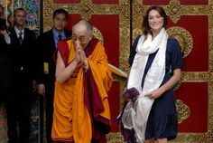 """Hmm...""""Blessing must arise from within your own mind. It is not something that comes from outside. When the positive qualities of your mind increase and the negativities decrease, that is what blessing means. The Tibetan word for blessing means transforming into magnificent potential.""""  Pictured: His Holiness the Dalai Lama (L) with Carla Bruni-Sarkozy in France on Aug. 22, 2008."""