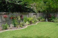 Southeast Texas backyard, I like the edging around the fence!
