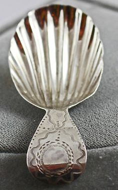 18th century English silver caddy spoon, scallop shell bowl and engraved handle curved/hooked at the end, c. 1700s, silver, UK