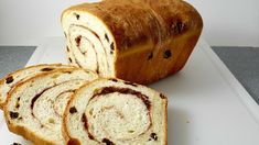 Homemade Cinnamon Swirl Raisin Bread is full of plump raisins and spiced with sweet sugar and cinnamon. It's perfect as toast slathered with butter.