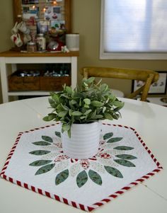 an aqua and red Christmassy table topper