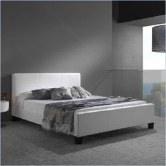 "Fashion Bed Group Euro Leather Platform Bed in White Finish - Sleek European-style modern platform bed in white colored synthetic leather. Available in Full, Queen and King sizes, this platform bed features a low profile footboard and a slat deck to eliminate the need for the box spring. Add modern European charm to your bedroom with the Fashion Bed Group Euro Leather Platform Bed. Features: Covered in a soft, but durable synthetic leather material White color Includes side rails and bent-wood slat deck; does not require a box spring Low profile platform footboard Modern Euro style Some assembly required Specifications: Full Dimensions: 36.75"" H x 57"" W x 86"" D Queen Dimensions: 36.75"" H x 63"" W x 91"" D King Dimensions: 36.75"" H x 79"" W x 91"" D Full Weight: 111 lbs Queen Weight: 120 lbs King Weight: 138 lbs"