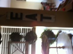 Eat sign hobby lobby paper mâché letters sprayed black on reclaimed wood