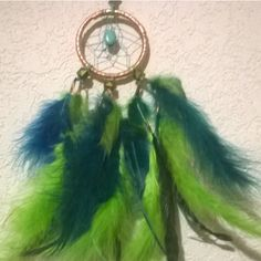 Carnival Peacock Dream Catcher dreamcatcher with a Kingman Mine... ($21) ❤ liked on Polyvore featuring home, home decor, handmade home decor, turquoise home decor, turquoise home accessories, peacock home decor and car interior decor