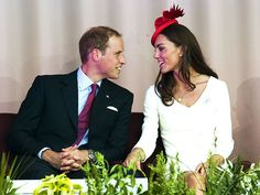 BODY LANGUAGE  Earlier in the day, Kate keeps a close eye – and hand! – on her Prince amid more Canada Day festivities.