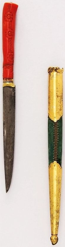 Ottoman kard dagger, 18th to 19th century, steel, brass, wood, velvet, coral, gold, crystal, L. with sheath 12 1/8 in. (30.8 cm); L. without sheath 9 1/4 in. (23.5 cm); L. of blade 5 1/4 in. (13.3 cm); W. 11/16 in. (1.7 cm); Wt. 2.5 oz. (70.9 g); Wt. of sheath 1.3 oz. (36.9 g), Met Museum, Bequest of George C. Stone, 1935.