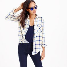 """The oversized shirt you love to steal from him but better, because it's shrunken down to fit you. We gave this one a windowpane check we love and made it supersoft in a lightweight flannel, so it's the perfect shirt for, well, pretty much any time. <ul><li>Body length: 27 1/2"""".</li><li>Cotton.</li><li>Long roll-up sleeves.</li><li>Chest pockets.</li><li>Machine wash.</li><li>Import.</li></ul>"""