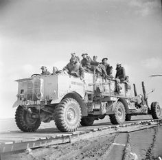 An AEC Matador tows a 4.5-inch field gun across a wooden track built across soft ground on the border between Libya and Tunisia, 23 February 1943.