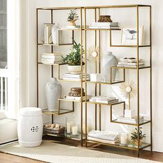 Our Lorna Bookshelf blends airy elegance with Chinoiserie allure. The sleek geometric frame has six glass shelves that create staggered floating stage Living Room Shelves, Living Room Decor, Bedroom Decor, Vitrine Design, Regal Design, Glass Shelves, Wall Shelves, Gold Bookshelf, Bookshelf Ideas