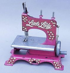 Image from http://coolspotters.com/files/photos/961950/artcraft-little-lady-toy-sewing-machine-profile.jpg.