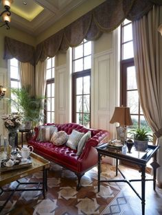 French style Villa. I really like the brown colors with the red sofa.