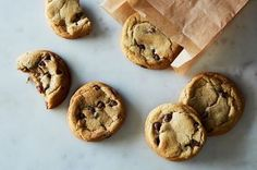 """The best cookies I had all year—and I eat a lot of cookies—were Andrea Bemis' Mint Chocolate Chip Cookies from her book <a href=""""https://www.amazon.com/Dishing-Up-Dirt-Recipes-Cooking/dp/0062492225"""">Dishing Up the Dirt</a href>. Their texture is the ideal amalgam of crispy and soft—a defined crust with visible veins of tenderness—but it is their underlying flavor that makes them true winners.  To begin, you melt the butter with a he..."""