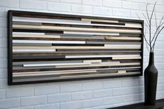 """Horizontal wood scrap art: 18""""x46"""" stained wood background: greys blacks whites with 1.5 inch brown/black frame"""