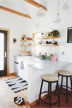 Airbnb: Portland Tiny House. Bright and airy kitchenette with cozy seating for two. Photo by local designer Emily Katz:  http://www.modernmacrame.com/