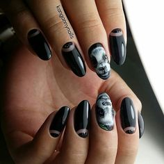 Rather simple Glossy Nail art design. With the tweak of silver beads on the simple black glossy nails, this nail art is simply awesome and enchanting.