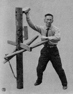 """Tung Chin-tsan, otherwise known as """"The Golden Dragon"""", practicing on his self-made wooden dummy. Tung Chin-tsan claimed to be a master of Shaolin and Wudang styles, as well as Plum Blossom Fist. Unfortunately, he was also known for being a member of the Black Dragons, a faction of Triads, and actually served time in prison for his association with them. Despite his notoriety, he was believed to have over ten thousand students in total and was a well respected master."""