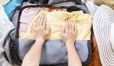 Koffer richtig packen: Falte empfindliche Kleidung