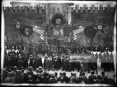 MOSCOW, RUSSIA - 7 NOVEMBER 1919: Vladimir Ilyich Ulyanov Lenin (in the middle of the picture) in the Red Square during the 2nd anniversary celebrations of the Great October Revolution. Lenin is watching a parade of workers. Russia, 7th November 1919. Photographer: L. Leonidov. (Photo by Laski Diffusion/East News/Getty Images)