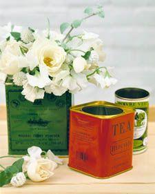 Vintage tea tins with flowers as centerpieces/decoration