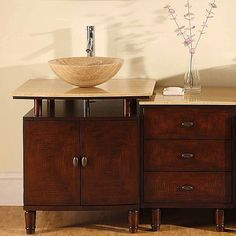 This Travertine stone counter top single sink vanity cabinet features an interchangeable Travertine stone vessel sink. This vanity captures timeless beauty and is hand finished to bring out its unique character.