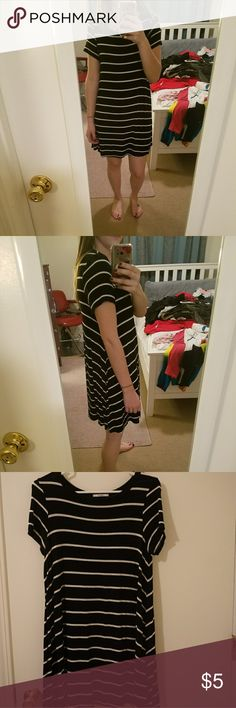 Black and white stripped dress Size tag was cut off. It is a size small though but it baggy and has alot of stretch. Very cute tee shirt dress. I am 5'5 and it falls right above my knees. Acemi Dresses Midi