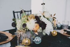 Gold, burgundy and white centerpiece- might be pretty to mix in other colors? This looks very elegantly fall, just without the disco balls.