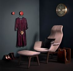 Decorate in film noir style. Dots wall hooks by Muuto, Mabel dress by Ivana Helsinki, evening bag by Minna Parikka, Ventura easy chair by Poliform, pillow case by H&M Home.
