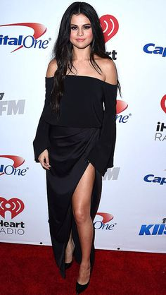 Selena Gomez in a black off-the-shoulder dress with thigh-high slit