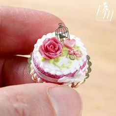 Check out this beautiful pink rose cake! I love the cute golden birdcage decoration :) www.parisminiatures.etsy.com