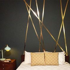 Here is a super inexpensive way to accent a wall. This is gold foil tape I got it on Amazon. It comes off super easy if you make a mistake too!  Try something new! #cottonwoodcanopy #accentwall #masterbedroom #interiordesign #moderndecor #foiltape