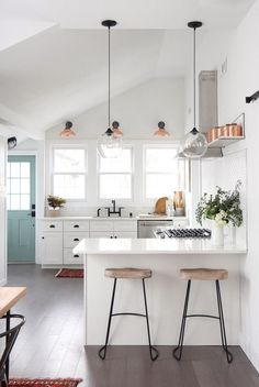 DIY-extraordinaire Jenni Radosevich, of I Spy DIY, took on the bold feat of flipping an old home in Milwaukee for HGTV's My Flippin Friends. See how she did it on Domino!