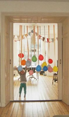 Ballooons tied to streamers dangling from a string, no Helium... Save money!